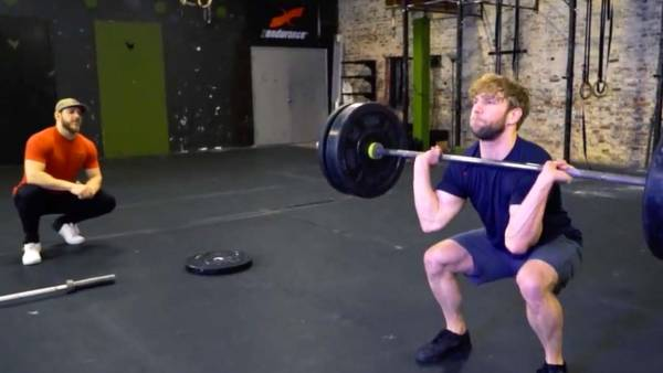 Men's Fitness Deputy Editor Zack Ziegler attempts the clean and jerk at Crow Hill CrossFit in Brooklyn, New York