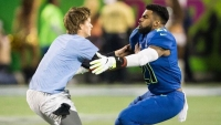 Watch: Ezekiel Elliott Tackles Fan on Field at Pro Bowl, Then Beats Him in 40-yard Dash