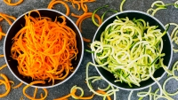 Bowl of Carrot Spaghetti and Bowl of Zoodles