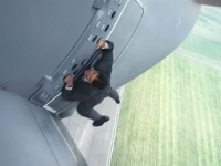mj-390_294_watch-tom-cruise-hang-off-the-side-of-an-airplane