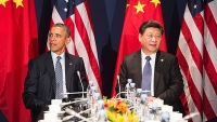President Barack Obama sits with Chinese President Xi Jinxing during a bilateral meeting ahead of the opening of the UN conference on climate change COP21.