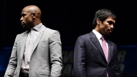 Manny Pacquiao (R) and Floyd Mayweather pose during a press conference on Wednesday.