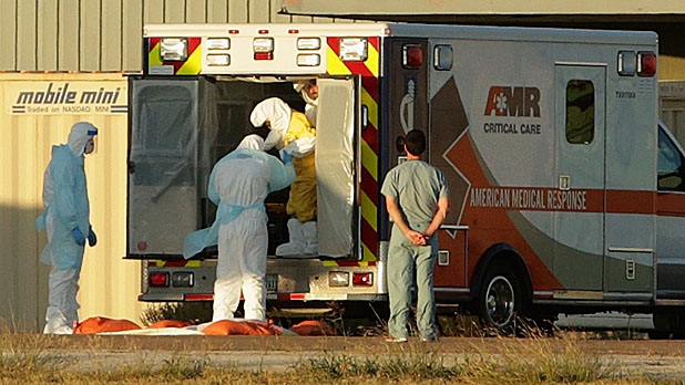 Texas Health Presybterian Hospital nurse Nina Pham is helped out of the back of an ambulance on the runway at Love Field airport October 16, 2014 in Dallas, Texas.