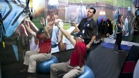 Sean Cochran gives golfers fitness tips at the American Express Championship Experience at the 2013 U.S. Open.