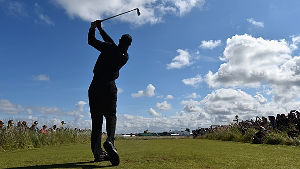 Tiger Woods of the United States tees off during a practice round prior to the start of The 143rd Open Championship at Royal Liverpool on July 15, 2014 in Hoylake, England.