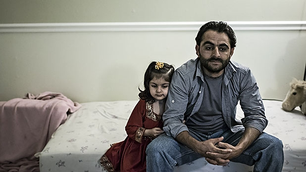 Rafi, an Afghan translator for numerous US military units, lives in a small unfurnished apartment complex with his wife and two children