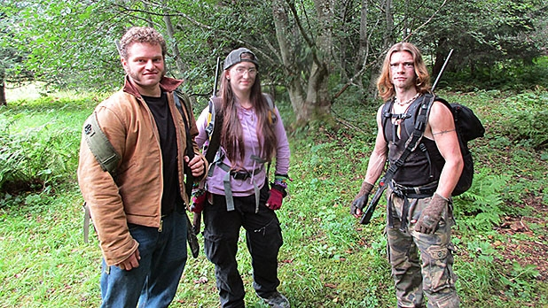 Gabe, Bird, and Bear on the hunt for deer in the mountains above Browntown.