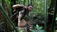 Lucas Weiss and a freshly hunted peccary, a principal source of meat for the Secoya people.