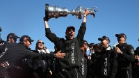 Oracle Team USA skippered by James Spithill celebrates onstage after defending the Cup as they beat Emirates Team New Zealand to defend the America's Cup during the final race on September 25, 2013 in San Francisco, California.