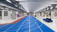 The hallways of Narita International Airport in Tokyo look like an indoor running track.