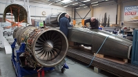 Engineers work on the carbon-fibre body of the Bloodhound SSC vehicle currently taking shape at its design centre in Avonmouth on March 5, 2015 in Bristol, England.