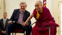 Robert Thurman and the Dalai Lama attend a news conference together.