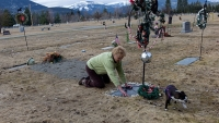 Activist resident Gayla Benefield visits the town cemetery