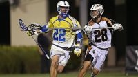 BOCA RATON, FL - JULY 25: Casey Powell #22 of the Florida Launch is defended by Will Koshansky #28 of the Rochester Rattlers during the game at FAU Stadium on July 25, 2015 in Boca Raton, Florida. (Rob Foldy / Getty Images)
