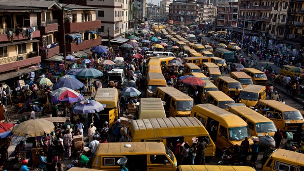 Yellow minibuses, or danfos, clog the streets in a city with only 68 (working) stoplights over 385 square miles.