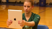 A boxer tests herself for signs of a concussion using an iPad app developed at the University of Notre Dame.