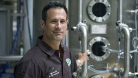 Dogfish Head founder Sam Calagione standing in his Milton, Delaware production brewery.