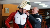 A skier dons the white Dainese D-air Ski airbag vest before a test run — and crash.