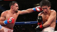 Robert Guerrero lands a punch on Yoshihiro Kamegai in their welterweight bout in Los Angeles. Guerrero won by unanimous decision.