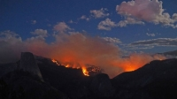 The Meadow Fire raged east of the Half Dome on Sunday, September 8, 2014.