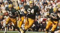 Green Bay Packers guard Jerry Kramer (64) leads the blocking for running back Elijah Pitts (22) during the Super Bowl I, a 35-10 victory over the Kansas City Chiefs on January 15, 1967.