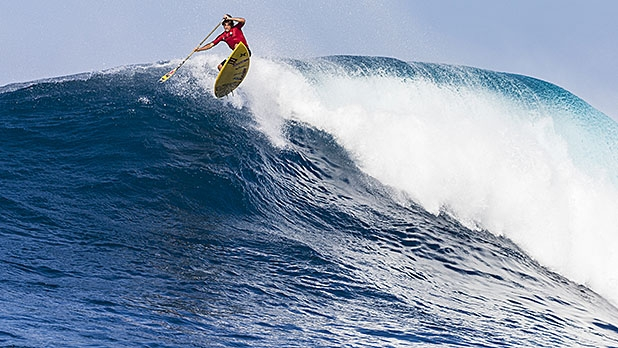 Kai Lenny rides his Stand-Up Paddle on a big wave at the North Shore in Haleiwa, Hawaii, December 9, 2014.