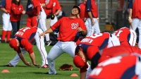 Washington Nationals starting pitcher Gio Gonzalez (47) has a laugh during stretching on the first day of full squad workouts on February 25, 2012 in Viera, Florida.