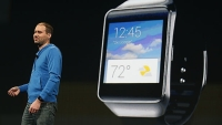 David Singleton, Director of Engineering of Android at Google, stands in front of a Samsung Gear Live watch during the Google I/O Developers Conference at Moscone Center on June 25, 2014 in San Francisco, California.