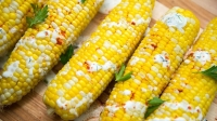 mj-618_348_grilled-corn-with-tzatziki-crema-17-ways-to-make-corn-this-summer