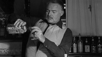 Ernest Hemingway mixes a drink in Cortina d'Ampezzo, 1948.