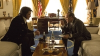 Michael Shannon as Elvis Presley sits across from President Nixon, played by Kevin Spacey.