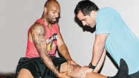 "Chicago Bears' Matt Forte working with physical therapist David Reavy. Forte credits Reavy for making him ""one of the most durable running backs in the NFL."""