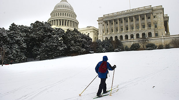 A man cross-country skis outside the US Capitol in Washington, DC, March 3, 2014 after an early morning snow storm.