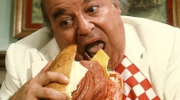 Actor Sorrell Booke, as Jefferson Davis 'Boss' Hogg, devours a large submarine sandwich in a scene from the television series 'The Dukes of Hazzard.'