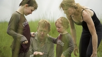 The family discovers a a leech after bathing the elephants in Chitwan National Park.