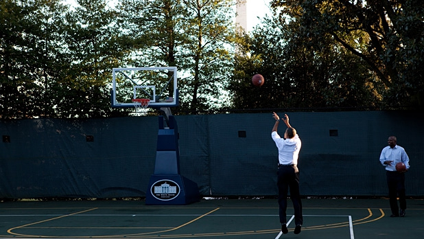 President Barack Obama shoots hoops with his personal aide, Reggie Love, at the White House Basketball Court, Jan. 18, 2010.