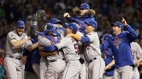 The New York Mets celebrate after defeating the Chicago Cubs in game four of the 2015 MLB National League Championship Series at Wrigley Field on October 21, 2015 in Chicago, Illinois. The Mets defeated the Cubs with a score of 8 to 3 to sweep the Championship Series.