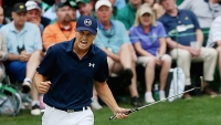 Spieth reacts to a par-saving putt on the 16th green during the final round of the 2015 Masters.