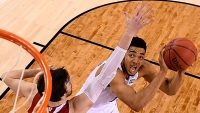 Karl-Anthony Towns of the Kentucky Wildcats looks to shoot against Frank Kaminsky of the Wisconsin Badgers in the second half during the NCAA Men's Final Four Semifinal at Lucas Oil Stadium on April 4, 2015 in Indianapolis.