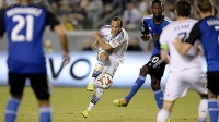 Landon Donovan #10 of the Los Angeles Galaxy hits a shot on goal against San Jose Earthquakes on August 8, 2014, in Carson, California.