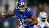 Odell Beckham Jr. carries the ball after the catch against the Dallas Cowboys.