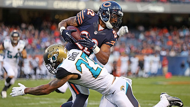Matt Forte #22 of the Chicago Bears is tackled by Dwayne Gratz #27 of the Jacksonville Jaguars during the first quarter of a preseason game at Soldier Field on August 14, 2014 in Chicago, Illinois.