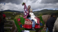 A man rides a horse with his son during a mass circumcision ceremony for young boys in the village of Draginovo, Bulgaria.