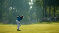 Lee Westwood hits an approach shot on the tenth hole during the first round of the 96th PGA Championship at Valhalla Golf Club on August 7, 2014 in Louisville, Kentucky.