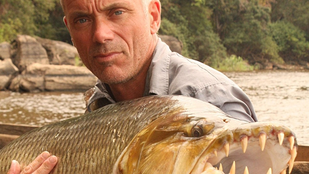 River Monsters host Jeremy Wade holding a Goliath Tigerfish in the Congo.