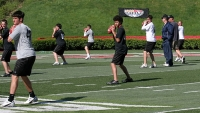 Instructors work with attendees of Steve Clarkson's Air 7 Quarterback University on the field at Rutgers University in Piscataway, New Jersey, May 6, 2007.