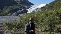 President Barack Obama stops at a lookout on September 1 while hiking past the Exit Glacier, part of the Harding Icefield in Seward, Alaska.