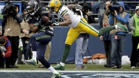 Seattle Seahawks cornerback Richard Sherman (25) intercepts a pass intended for Green Bay Packers wide receiver Davante Adams (17) during the first half of the NFL football NFC Championship game Sunday, Jan. 18, 2015, in Seattle.