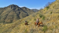 The private, 30,000-acre Los Baños ranch offers rugged horseback riding, climbing, and kayaking.