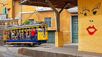 Passengers ride the historic tramway through Rio de Janeiro's Santa Teresa neighborhood.